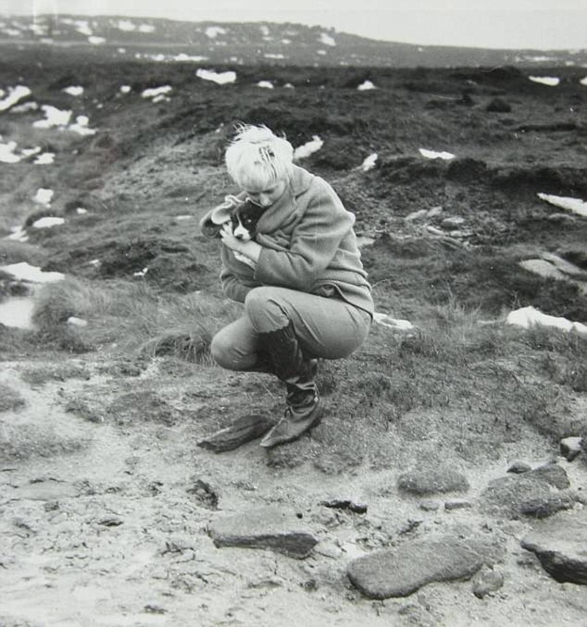 Brady and Hindley took their puppy to the moors with them to check on John and Pauline's graves. Myra Hindley is pictured holding the dog by the grave of John Kilbride on Saddleworth Moor